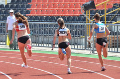 Girls running on track. Rear view. Royalty Free Stock Images