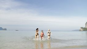 Girls Running From Water On Beach, Young Woman Group On Sea Vacation. Slow Motion 120 stock video footage