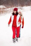 Girls runs at winter park Stock Image
