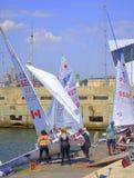 Girls sailing boats racers Royalty Free Stock Image