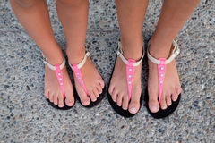 Girls with sandals on his feet Stock Image