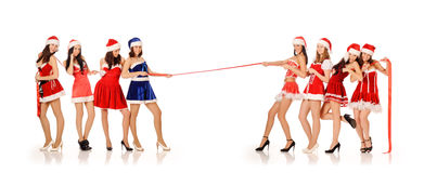 Girls in Santa Claus costumes Royalty Free Stock Image