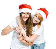 Girls in Santa hat Stock Images