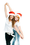 Girls in Santa hat Stock Images