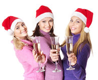 Girls in santa hat drinking champagne Royalty Free Stock Photo