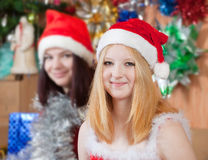 Girls in santa hats in christmas  eve Stock Photography