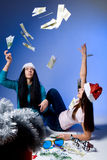Girls in Santa hats, throw up banknotes Royalty Free Stock Photography