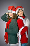 Girls in Santa's caps Royalty Free Stock Photography