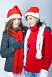 Girls in Santa's caps Stock Photography