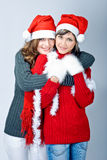Girls in Santa's caps Royalty Free Stock Photos