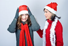 Girls in Santa's caps Royalty Free Stock Images