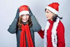 Girls in Santa's caps Royalty Free Stock Images