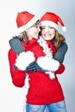 Girls in Santa's caps Stock Photo