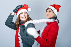 Girls in Santa's caps Royalty Free Stock Image