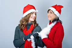 Girls in Santa's caps Royalty Free Stock Photos