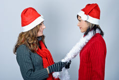 Girls in Santa's caps Royalty Free Stock Photo