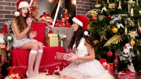 Girls Santa`s helper wrapping gifts stock video footage