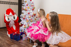 Girls saw Santa Claus who brought them gifts Stock Photography