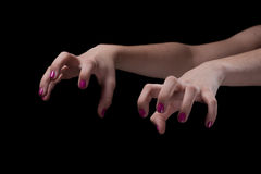 Scary hands. Girls scary hands on dark background Royalty Free Stock Photo