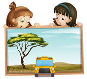 Girls and school bus Royalty Free Stock Images