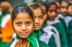 Girls in school uniforms in Bihar. Bohdgaya, Bihar - circa January 2012: Young girls in school uniforms stand in row at school in Bohdgaya, Bihar. Documentary Stock Images