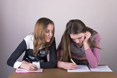 Girls in School writting in Notebook Royalty Free Stock Images