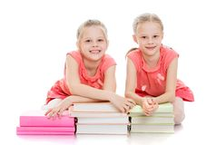 Girls schoolgirl with lots of books Stock Photography