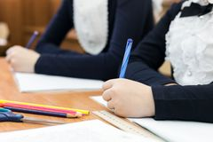 Children write an examination paper at school. stock photography