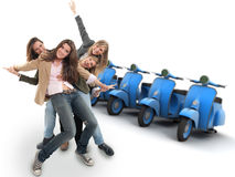 Girls and scooters. A group of happy girls and a line of scooters Royalty Free Stock Image