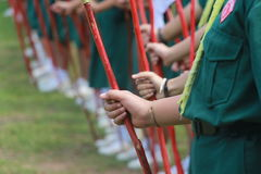 Girls scout line regulation closeup to hand holding pole. Regulation concept royalty free stock photo