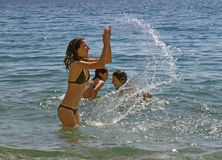 Girls and sea splash Royalty Free Stock Image