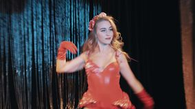Girls in sea themed red shrimp carnival costumes dancing on scene stock video footage