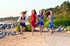 Girls on seacoast Royalty Free Stock Photography