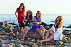 Girls on seacoast Royalty Free Stock Images