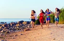 Girls on seacoast Stock Photo