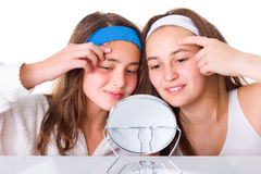 Girls searching for blemishes on theirs skin. Teeneger girls searching for blemishes on theirs skin Stock Photo