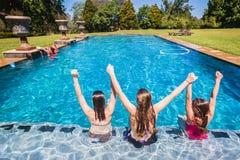 Girls Seated Swimming Pool Stock Photo