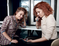 Girls seeing in cell phone Royalty Free Stock Images