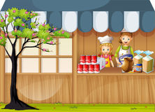 Girls selling food in foodstand Royalty Free Stock Photo