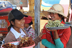 Girls Selling Foods at Skun Royalty Free Stock Photography