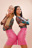 Girls sending kisses in pink leather dresses Royalty Free Stock Images