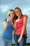 Girls sending text message Stock Photo