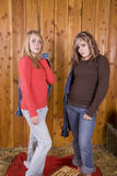 Girls serious in barn Stock Photos