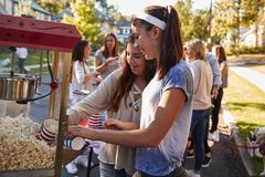 Free Girls Serve Themselves Popcorn At Neighbourhood Block Party Royalty Free Stock Photo - 108976075