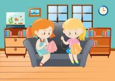 Girls sewing handkerchief in room