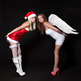 Girls sexy Santa Claus and Angel Stock Photo