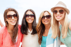 Girls in shades having fun on the beach. Summer holidays, vacation and beach activities - girls in shades having fun on the beach Royalty Free Stock Photography