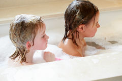 Girls Sharing Bubble Bath Royalty Free Stock Photography
