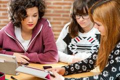 Girls sharing information on tablet. Stock Photography