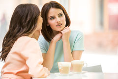 Girls sharing secrets Stock Photo